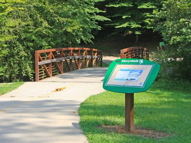 The first StoryWalk post at Umstead Park.